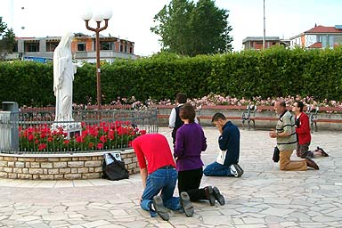 Image result for John Paul II bowing down to statue of Mary